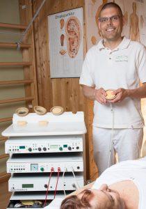 Schmerzlinderung Elektrotherapie München